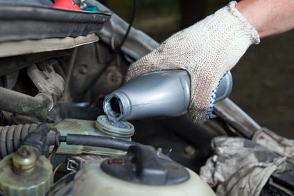 Mechanic providing preventative car maintenance