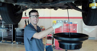 Technician Changing Oil | Rad Air