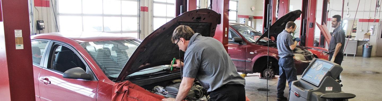 Rad Air Mechanic Examining Engine
