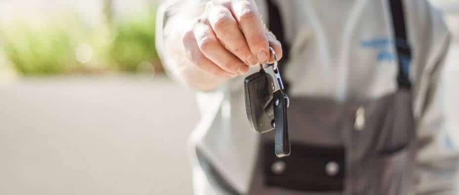 man handing off keys