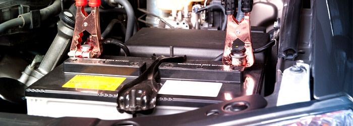 Jumper Cables on Car Battery