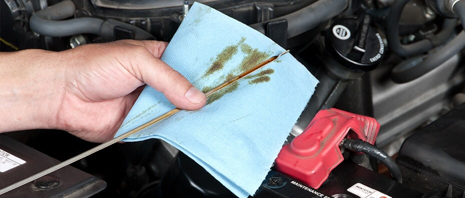 Mechanic Changing Oil in Car